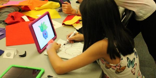 girl doing art on an iPad
