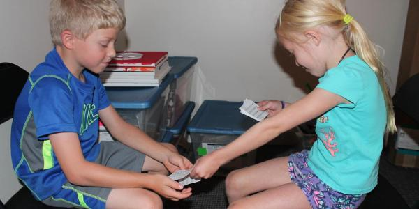 2 kids doing hands-on math project