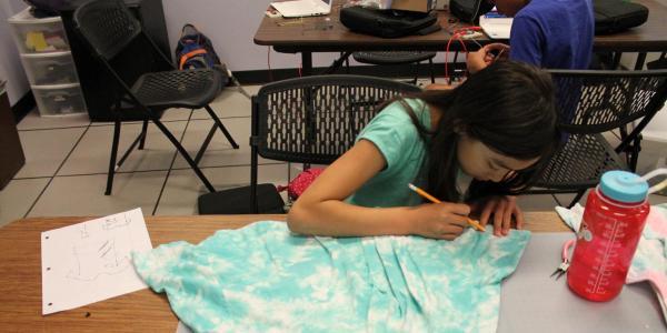 girl working on dress