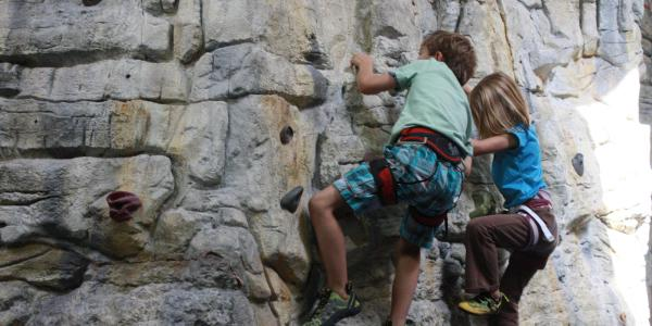 kids climbing on rocks