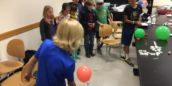 kids doing a balloon experiment
