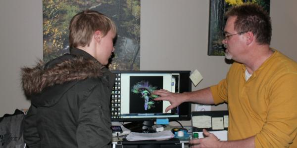 student and teacher looking at a brain scan