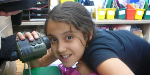 girl using night vision camera