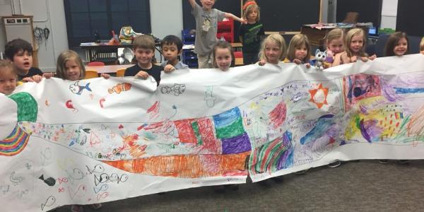 kids with ocean banner