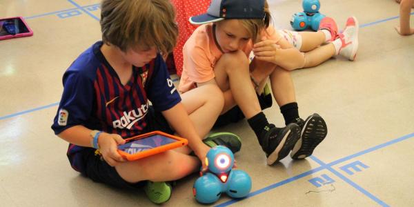 boys coding with a robot on an iPad