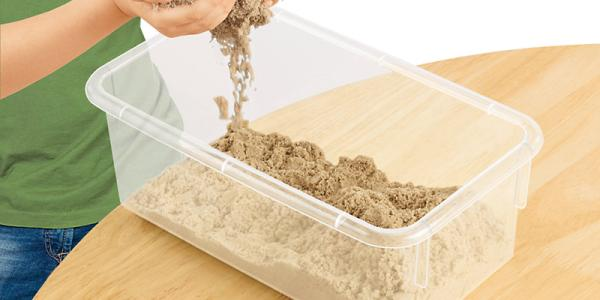 boys hands in kinetic sand