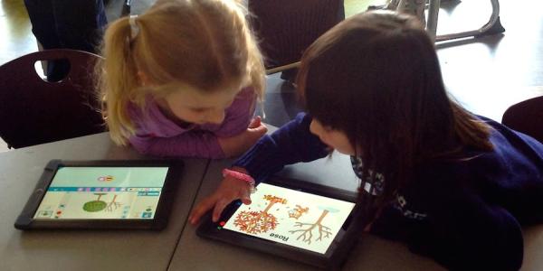 two girls playing on ipad