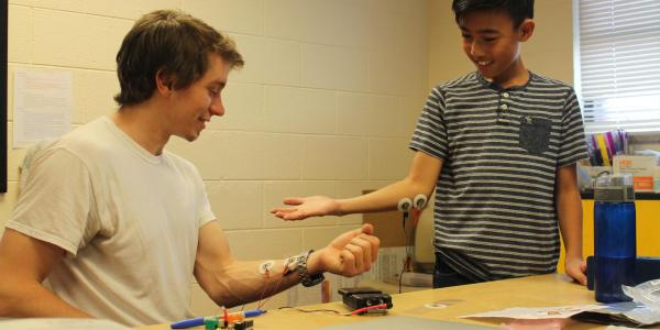 Instructor and student with sensors attached to their arms.