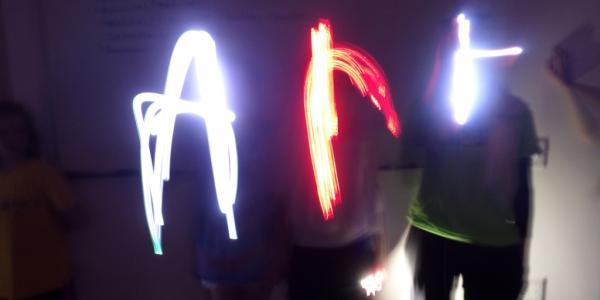 kids doing light art