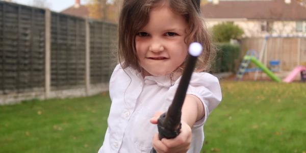 little girl with wand