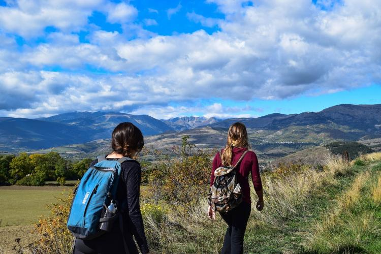 teens hiking in mountains