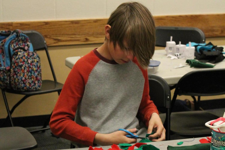 boy working on felt project