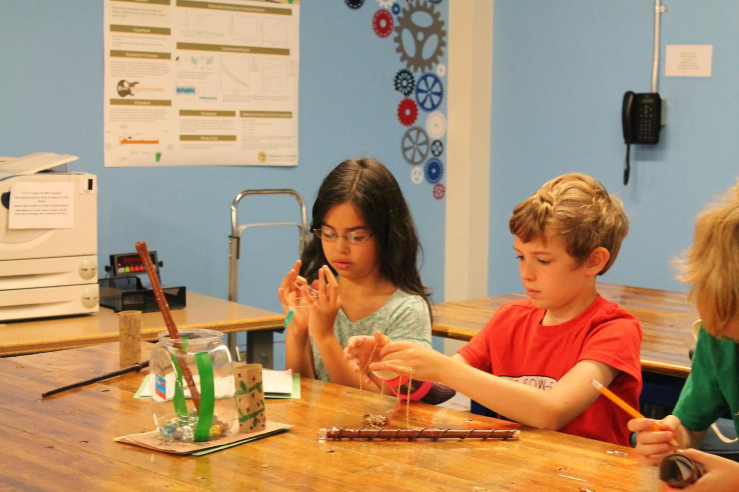 boy and girl working on crafts at table