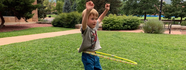 boy with hula hoop
