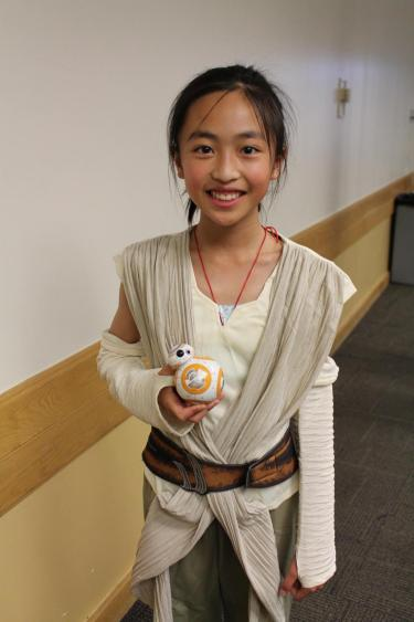 girl dressed up as Star Wars person