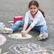 girl doing chalk art