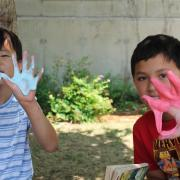 2 boys showing slimy hands