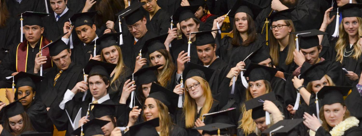 Graduating students move their cords