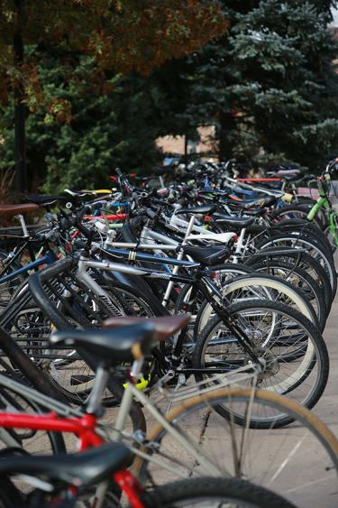numerous parked bikes on the CU campus