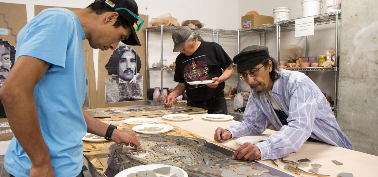 community members piece together a mosaic of Neva Romero, one of Los Seis, now memorialized in sculptures on CU Boulder's campus.