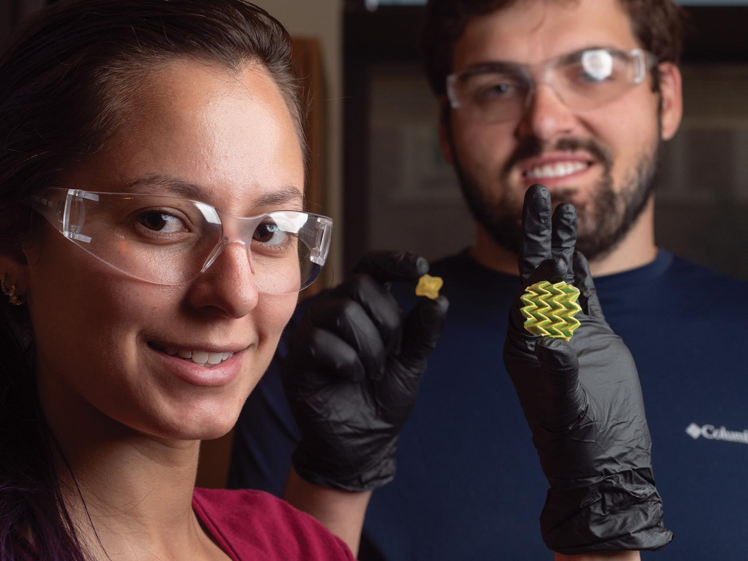 Researchers holding shape shifting material