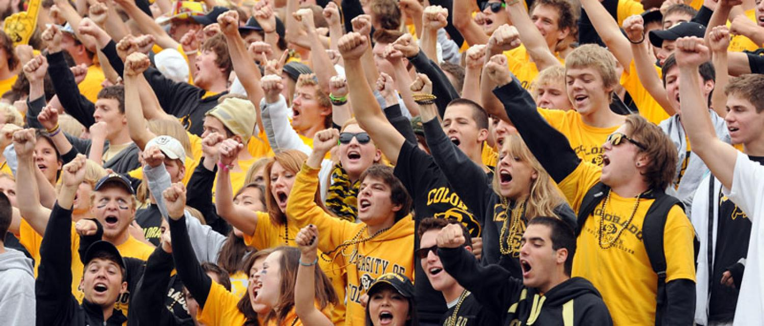 Students singing fight song at football game