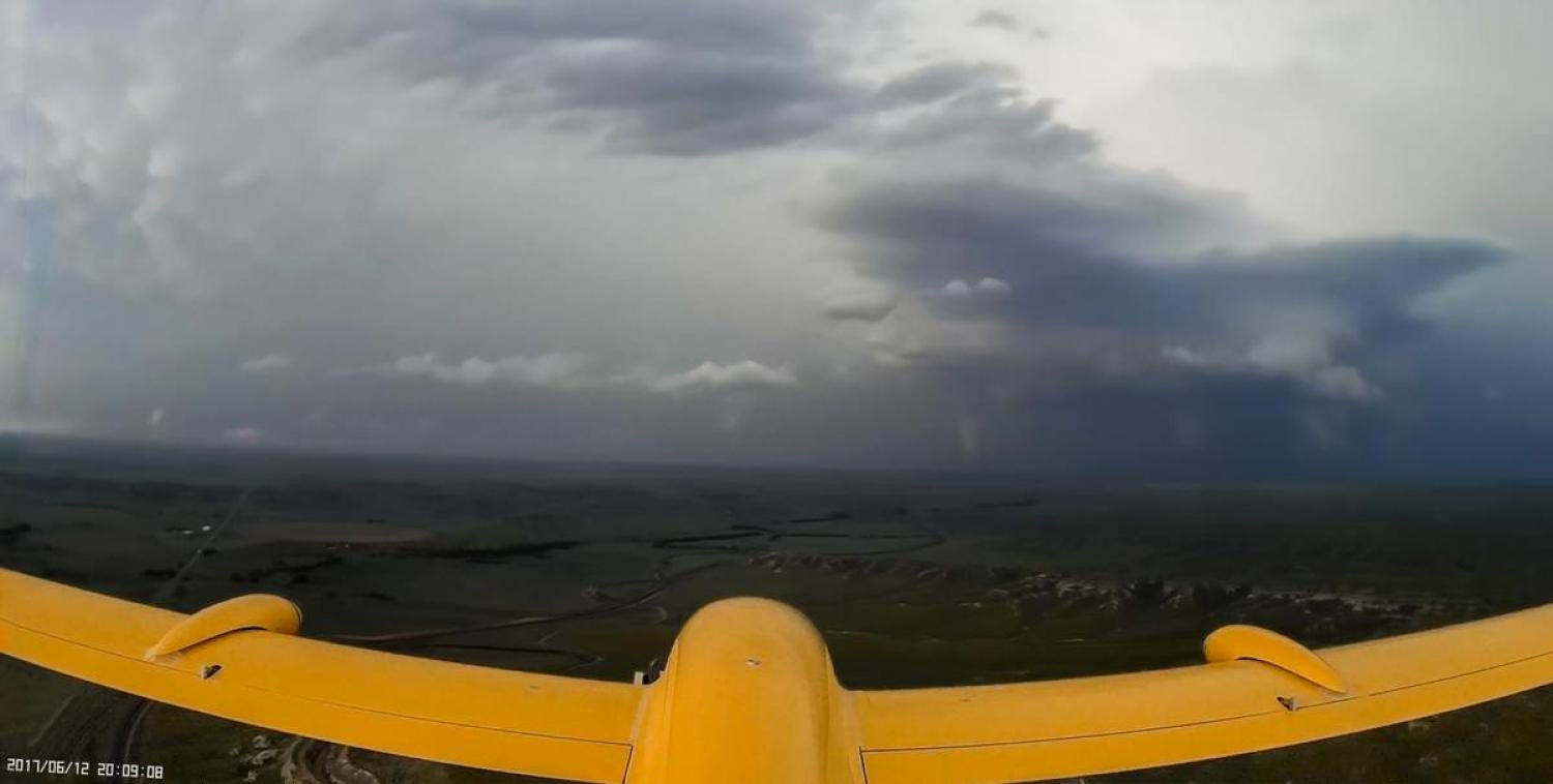 Project STORM team flies the IRISS TTwistor UAS toward a supercell with a tornado on the ground