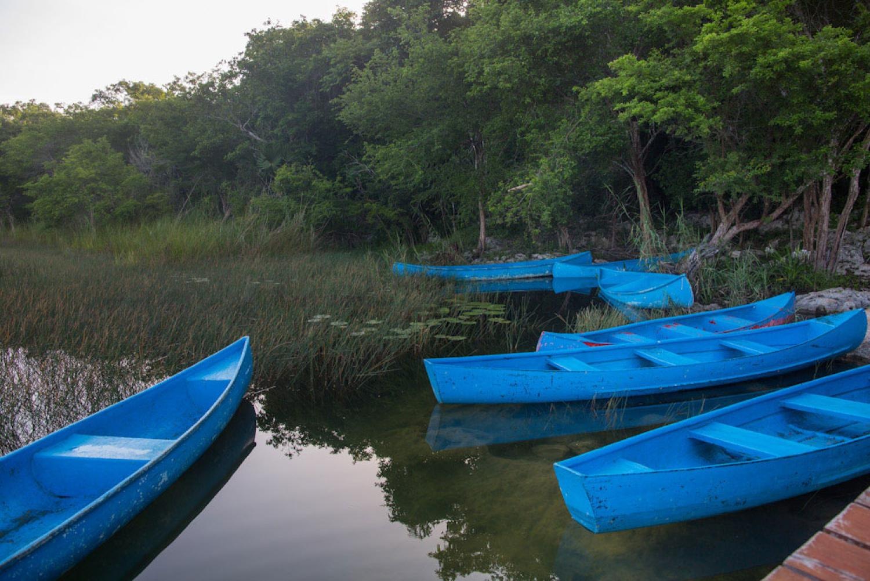 Laguna with blue canoes