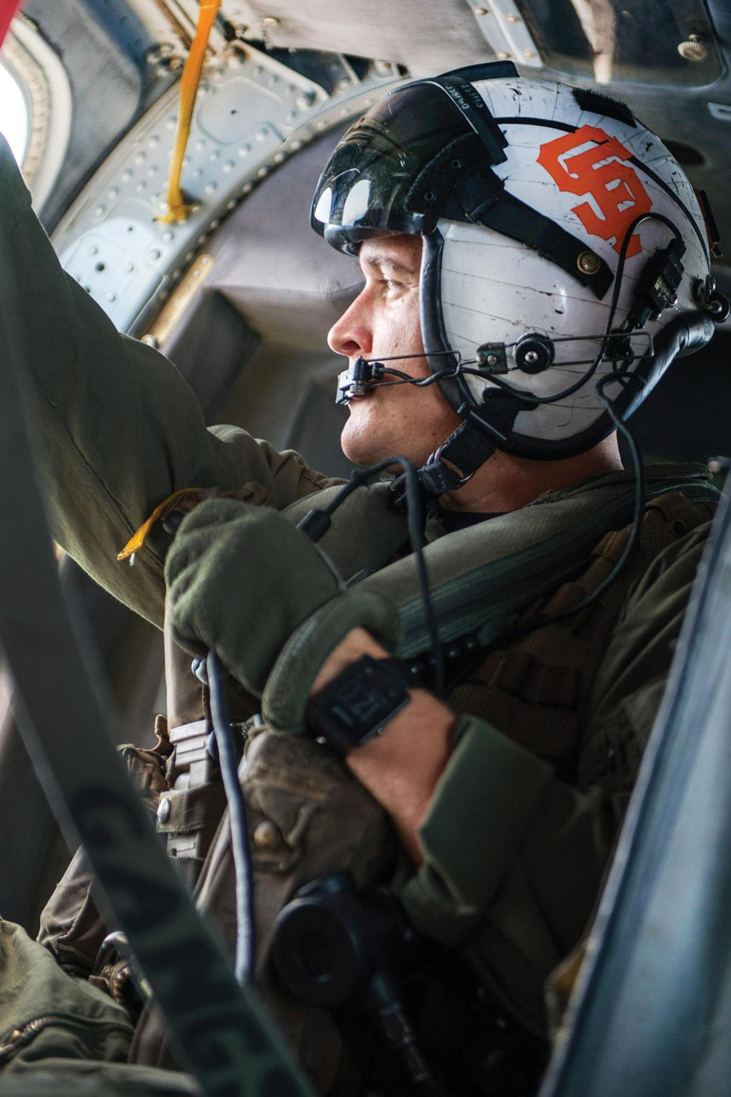 Navy Petty Officer 2nd Class Joshua Soderstrom flies an MH-60S Seahawk helicopter