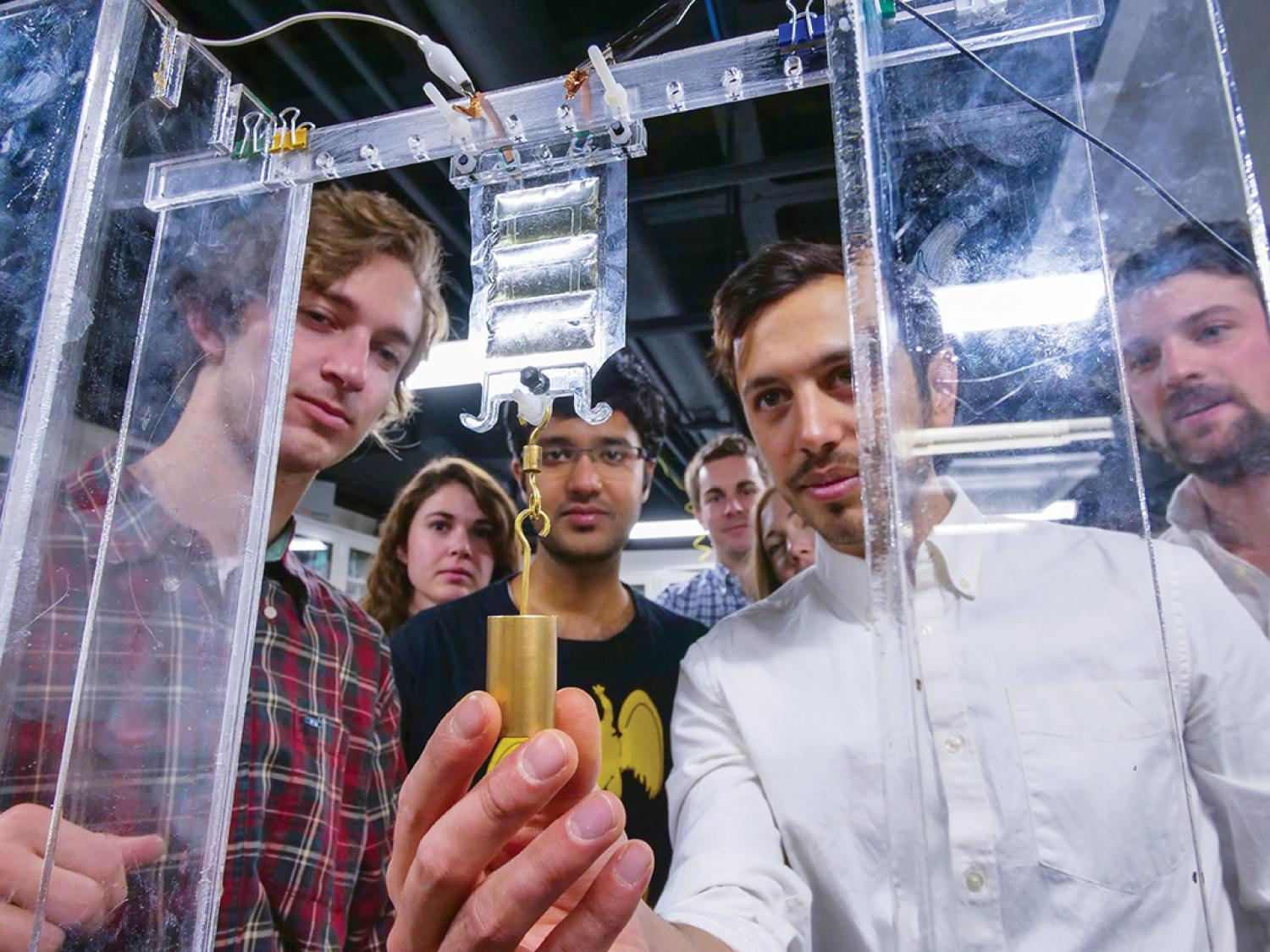 Research team testing soft, flexible device