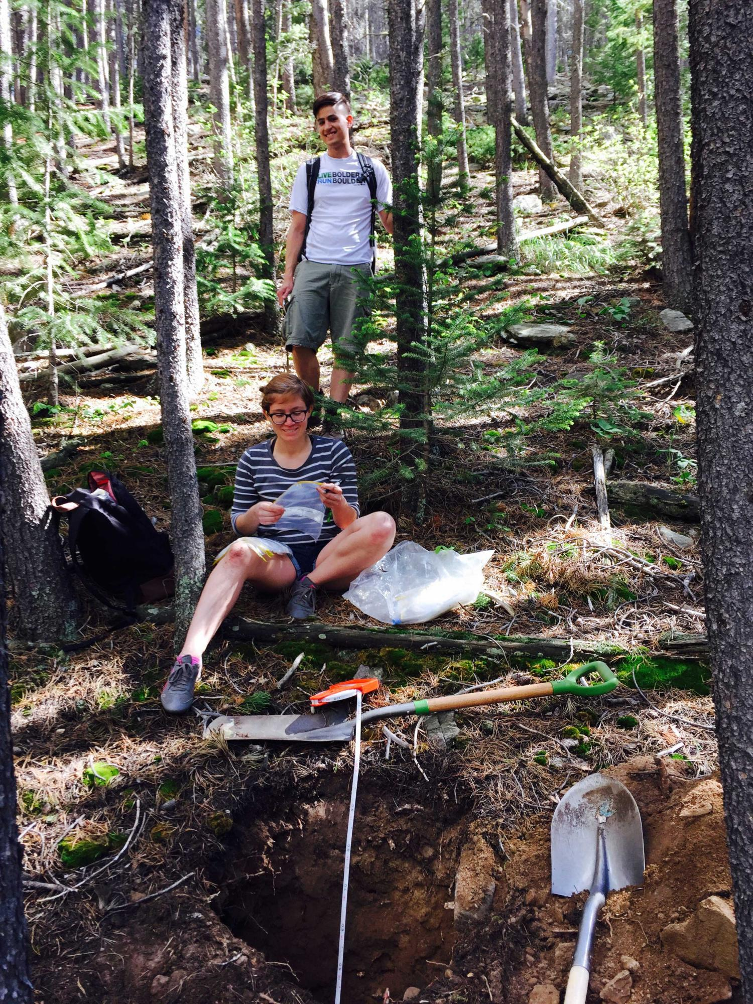 Scott-Wesley Bean and another student conducting research in the mountains