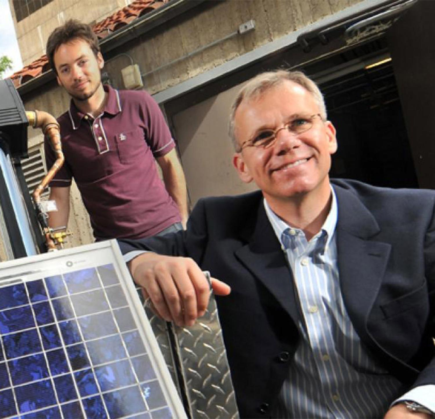 Dr. Gregor Henze's and team member with electric grid