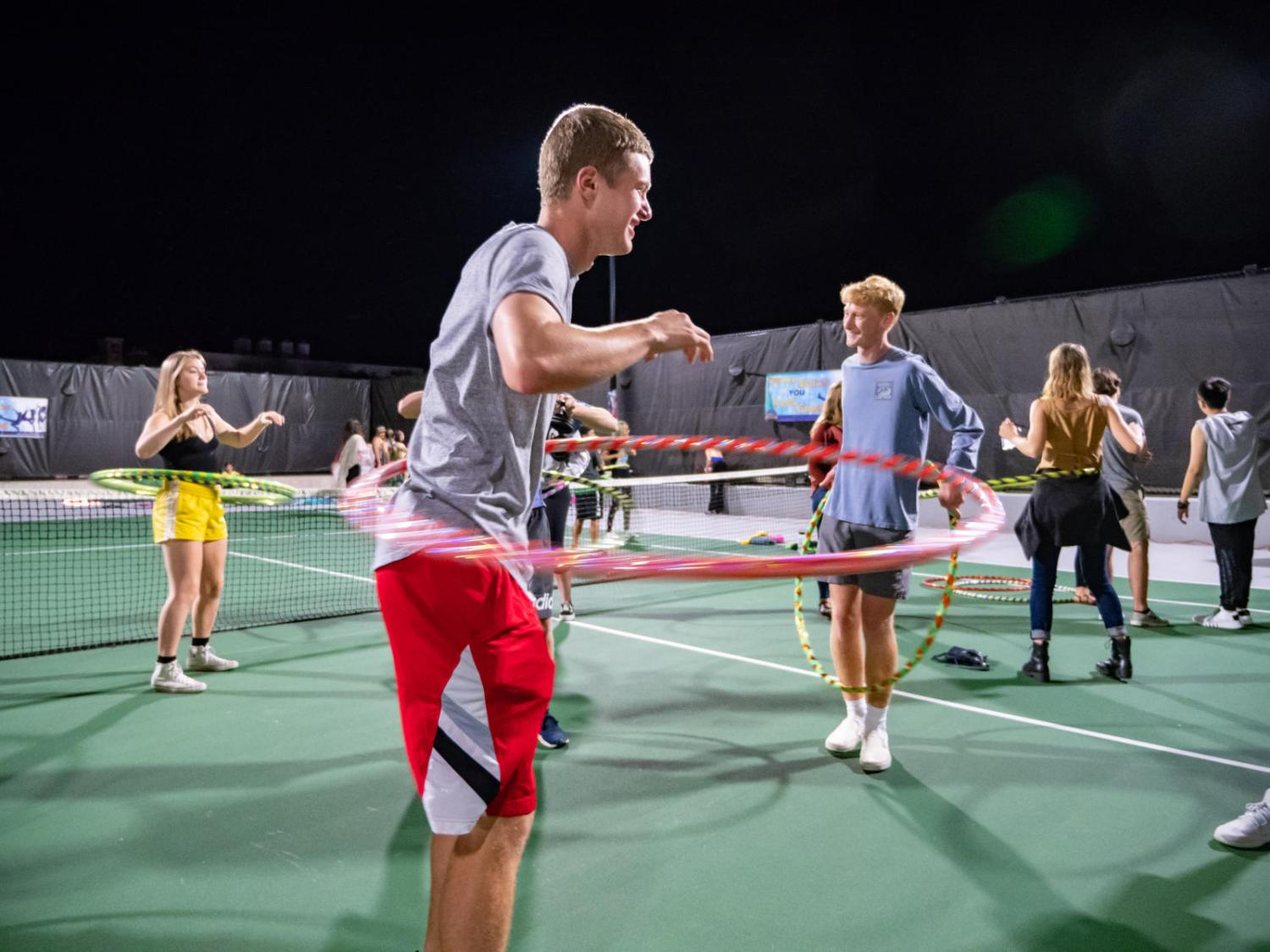 Students hula hooping outside on campus
