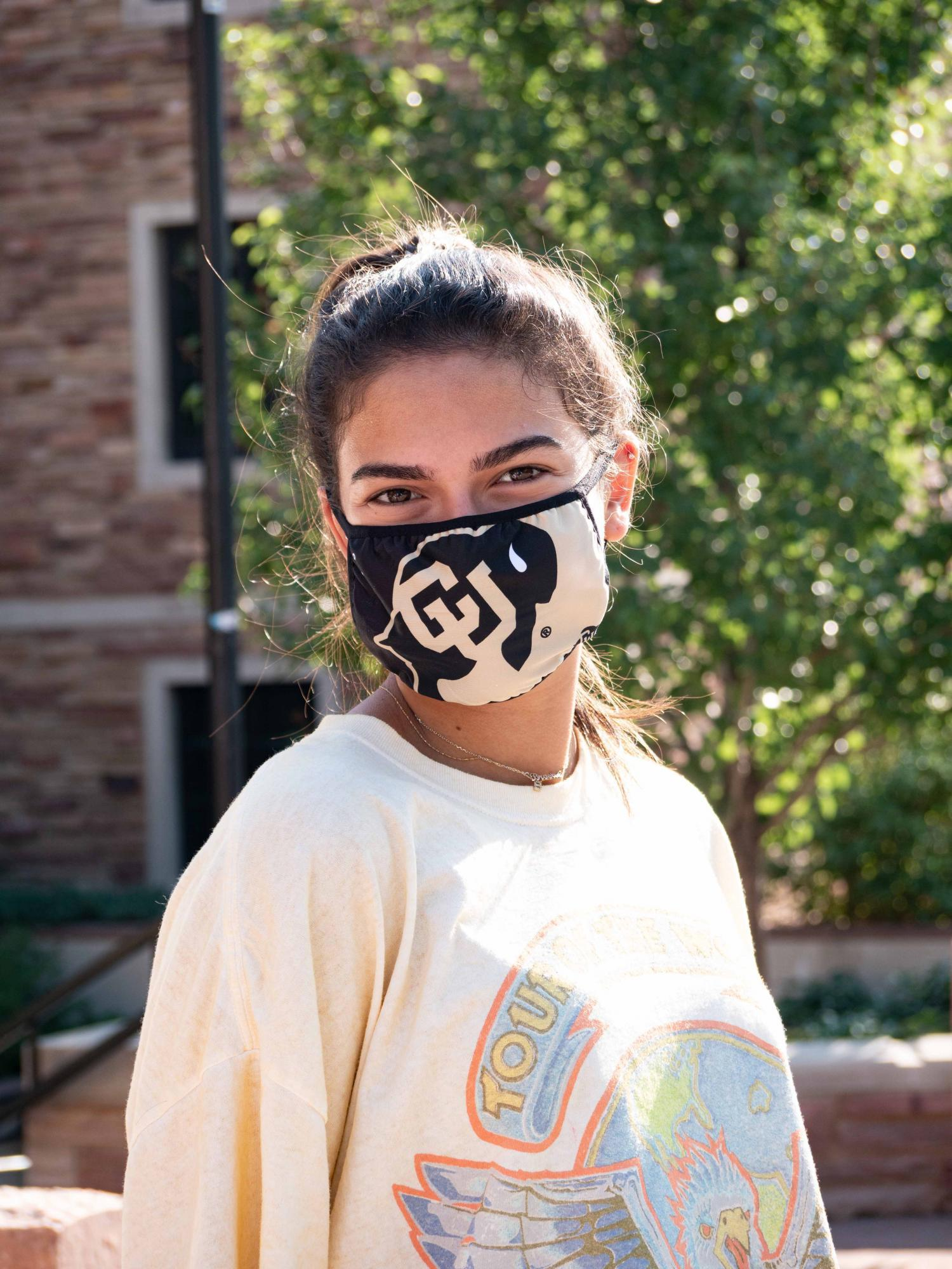 CU student wearing mask on campus