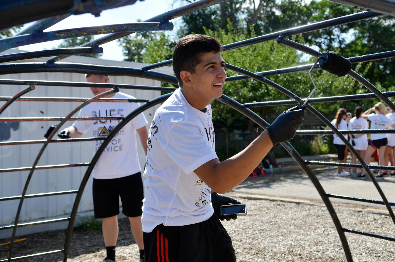 Students volunteering to paint playgrounds