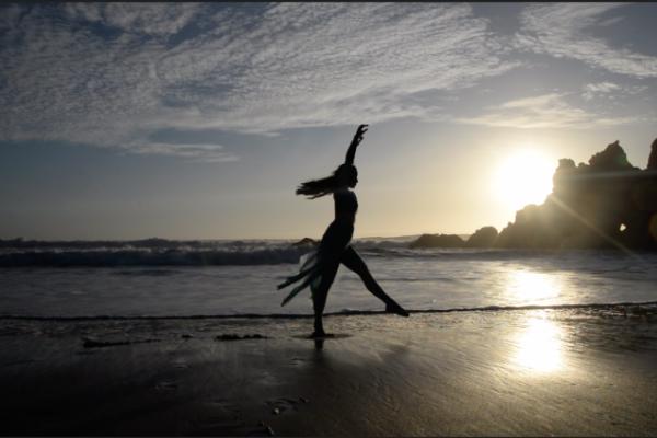 Rae Lewark performing on a beach