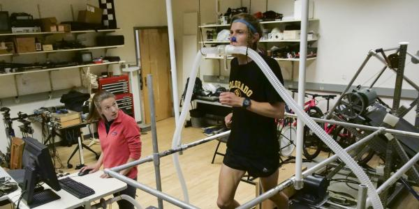 A runner tests the 4% on the treadmill at a CU lab