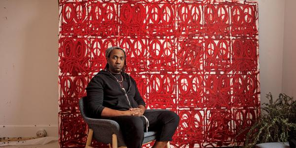 Rashid Johnson in front of a large painting