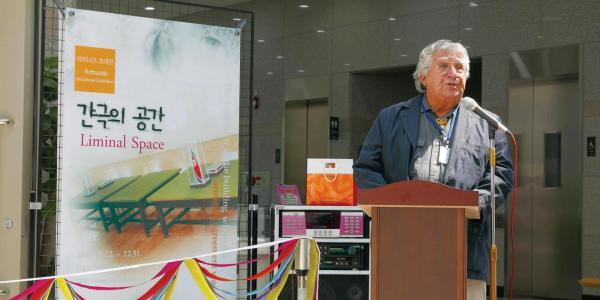 Professor at podium in South Korea