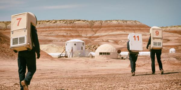 Researchers in front of the Mars Desert Research Station