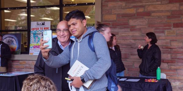 A student takes a selfie with Chancellor Phil DiStefano at the Health Hut event during the 2021 Health and Wellness Summit on the CU Boulder campus. (Photo by Glenn Asakawa/University of Colorado)
