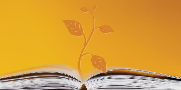 Open book and plant graphic