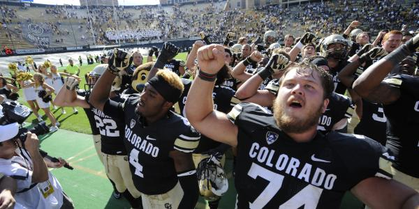 Alex Kelley sings fight song with teammates after a CU victory