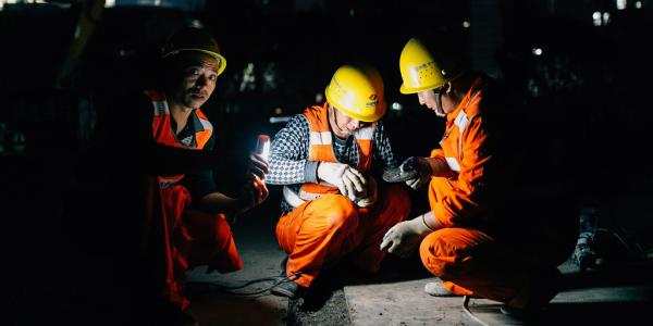 Construction workers at night
