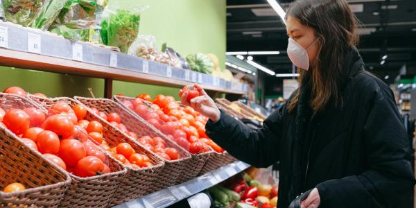 Stock image of a person wearing a face mask in a supermarket