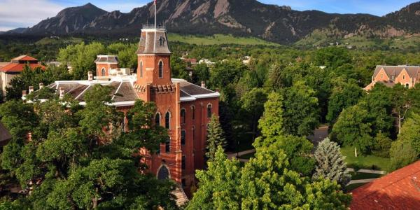 Old Main on CU Boulder campus with Flatirons in the background