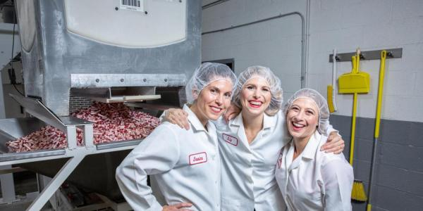 Smarties Candy Company co-president Jessica Dee Sawyer, left, with her sister Liz and cousin Sarah Dee.