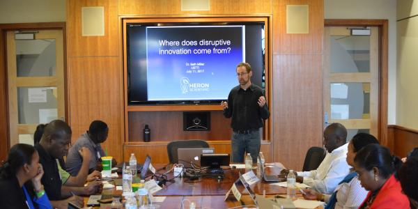 Seth Miller discusses disruptive technologies with USTTI participants