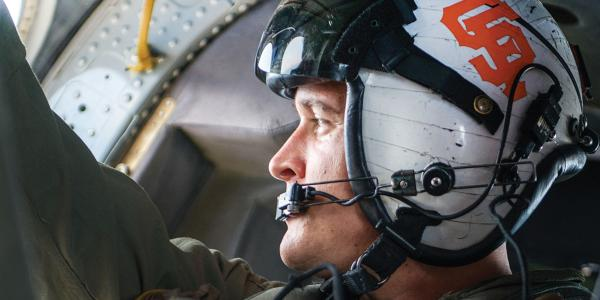 Navy Petty Officer 2nd Class Joshua Soderstrom flies an MH-60S Seahawk helicopter.