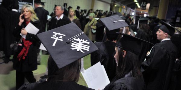 Graduates in subway corridor